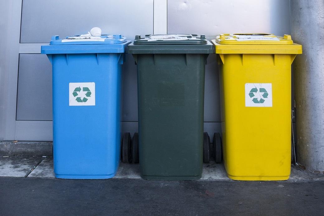 Three different recycling bins