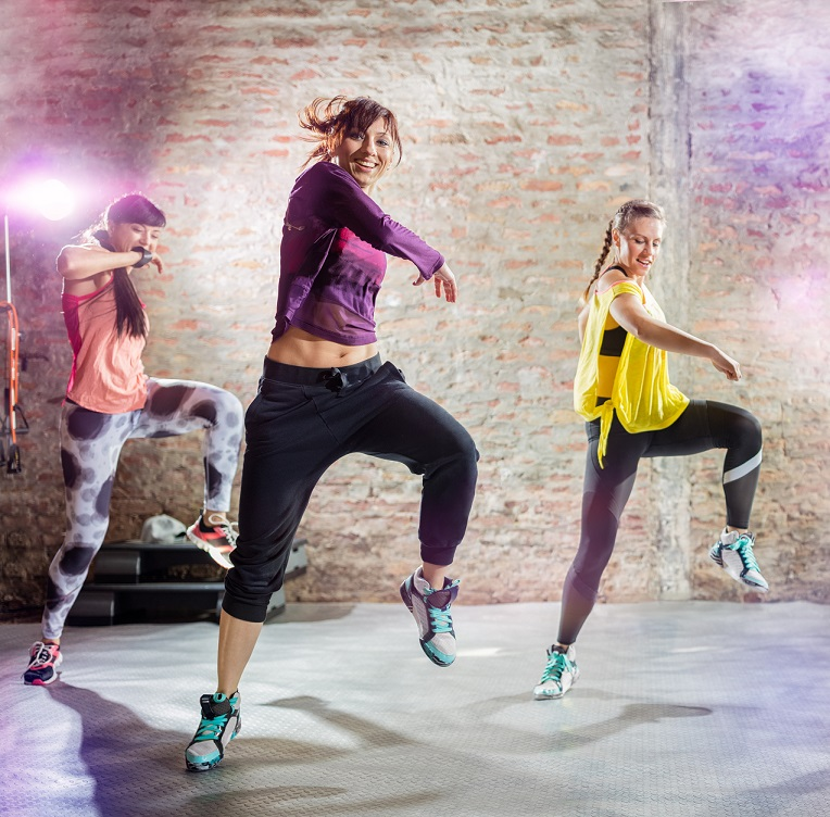 Three women in a Zumba lesson