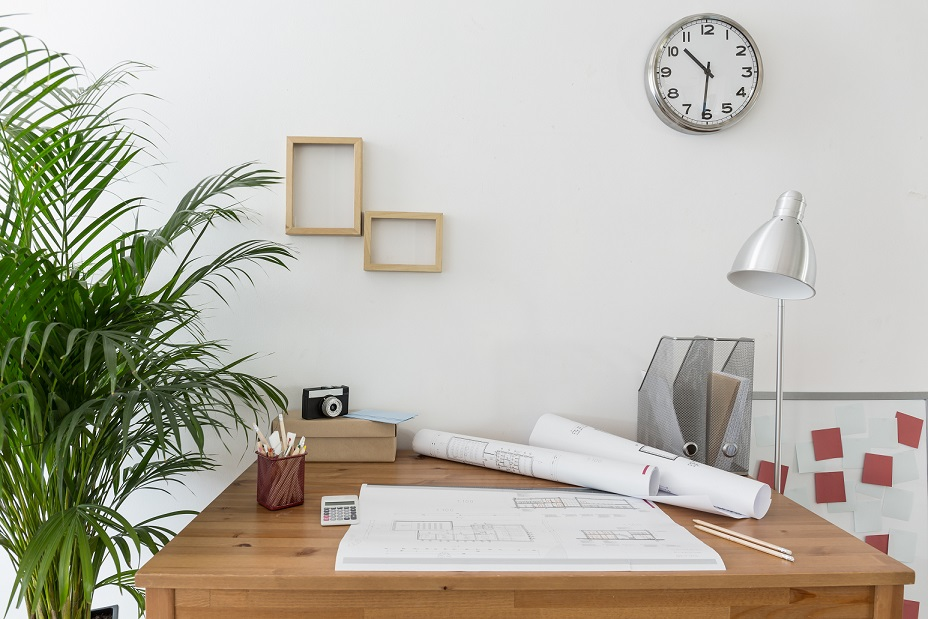 Creative space with house plans on the desk