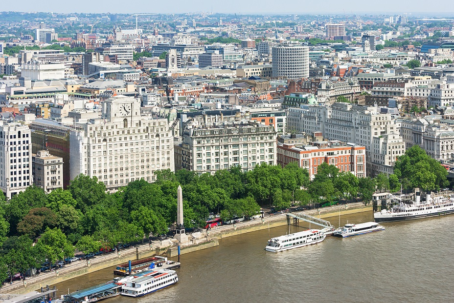 London panorama with Victoria Embankment on river Thames with Cleopatra's Needle and urban architectures. United Kingdom