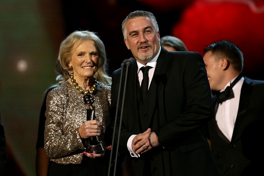 Paul Hollywood and Mary Berry collect the award for Best Factual Entertainment for The Great British Bake off during the 2015 National Television Awards at the O2 Arena, London.