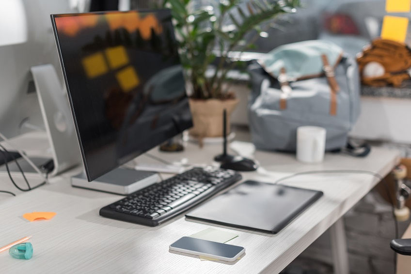 modern computer with blank screen at workplace in office
