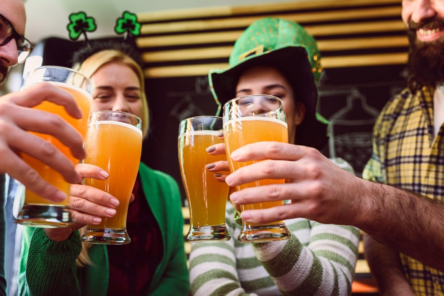 Group of Friends Celebrating St Patrick's Day at Beer Pub