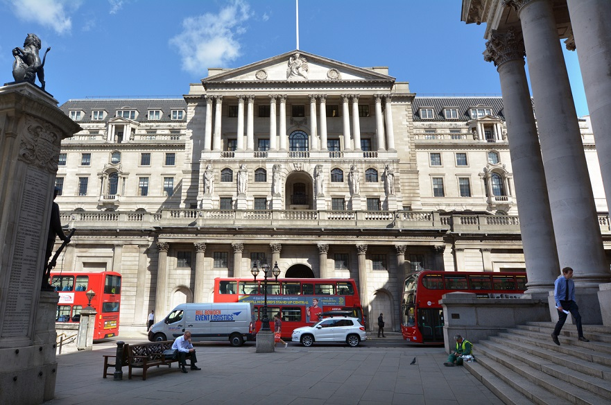 London, United Kingdom - May 13, 2015: People, cars and buses outside the Bank of England Headquarters in City of London. It's 1 of 8 banks authorised to issue banknotes in the United Kingdom, but has a monopoly on issue of banknotes in England and Wales